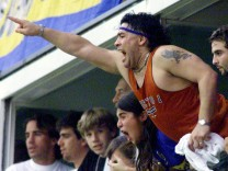ARGENTINE FORMER SOCCER STAR MARADONA CHEERS HIS TEAM BOCA JUNIORS DURING  A SOCCER MATCH AGAINST RIVER PLATE