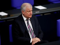 FILE PHOTO: German Interior Minister Horst Seehofer is seen before German President Frank-Walter Steinmeier's commemorative speech at Berlin's Reichstag to mark the 100th anniversary of the Weimar Republic, in Berlin