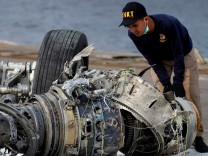 FILE PHOTO: An Indonesian National Transportation Safety Commission (KNKT) official examines a turbine engine from the Lion Air flight JT610 at Tanjung Priok port in Jakarta