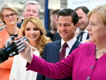 FILE PHOTO: German Chancellor Angela Merkel and Mexican President Enrique Pena Nieto tour the Hannover Messe
