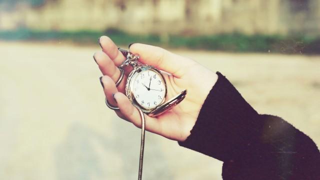 Pocket watch in hands