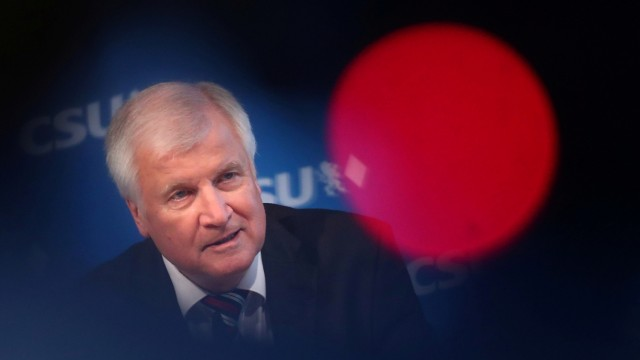 FILE PHOTO: German Federal Interior Minister Seehofer attends a news conference after a board meeting of the CSU in Munich