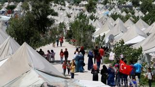 Syrian refugees stroll at a refugee camp in Osmaniye