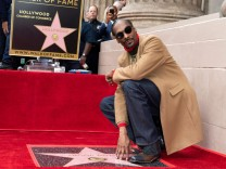 Rapper Snoop Dog unveils his star on Hollywood Walk of Fame