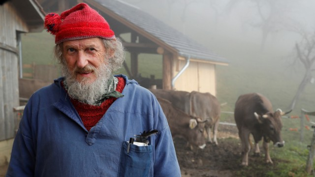 Capaul, the horned cow initiative founder poses at the Valengiron farm in Perrefitte