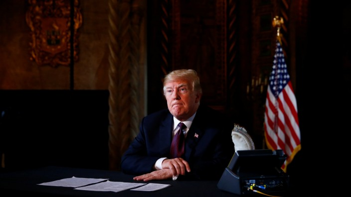 U.S. President Donald Trump takes questions from the media after speaking via teleconference with troops from Mar-a-Lago estate in Palm Beach