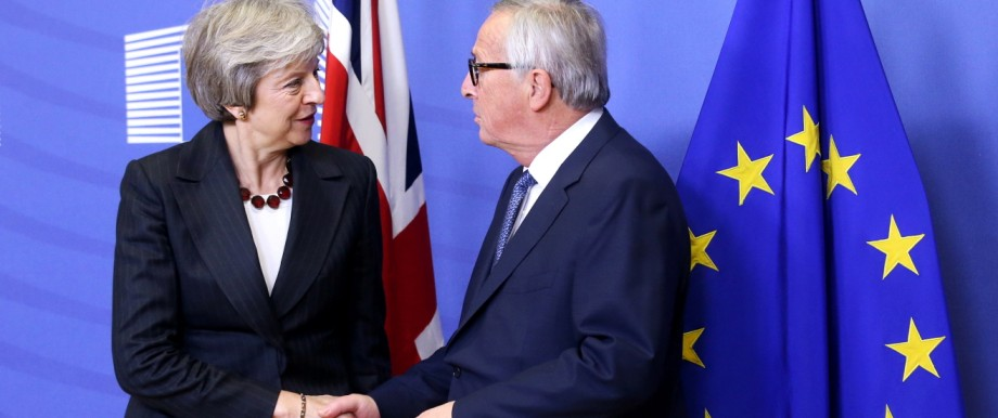 British Prime Minister Theresa May shakes hands with European Commission President Jean-Claude Juncker before a meeting to discuss draft agreements on Brexit, at the EC headquarters in Brussels