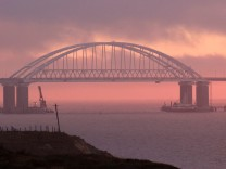 A general view shows a road-and-rail bridge, which is constructed to connect the Russian mainland with the Crimean peninsula, at sunrise in the Kerch Strait, Crimea