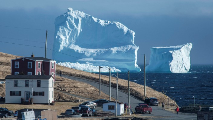 Residents view the first iceberg of the season as it passes the South Shore of Newfoundland