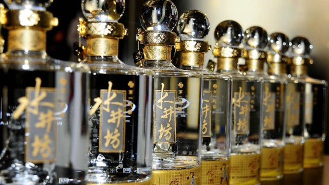 Bottles of Sichuan Swellfun baijiu are seen on display during a promotional event of the company in Beijing