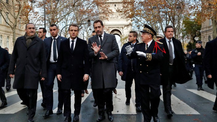 France's President Emmanuel Macron arrives to visit firefighters and riot police officers the day after a demonstration