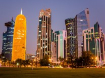 DOHA QATAR - MARCH 15 2018 Doha skyscrapers lit at night Marina Lystseva TASS PUBLICATIONxINxGE