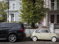 Small And Large Car In Notting Hill
