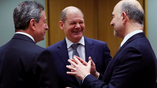 ECB President Mario Draghi, German Finance Minister Olaf Scholz and European Commissioner for Economic and Financial Affairs Pierre Moscovici attend a Euro zone finance ministers meeting in Brussels