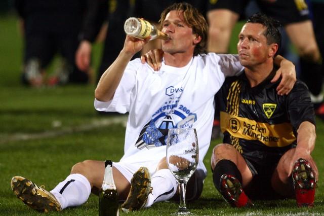 Aachen's Landgraf and Wosz of Bochum celebrate after soccer match in Aaachen