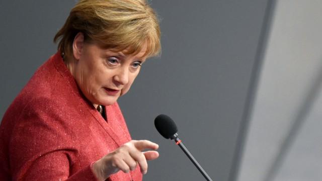 German Chancellor Angela Merkel addresses the lower house of parliament Bundestag in Berlin