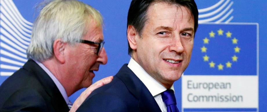 FILE PHOTO: Italian Prime Minister Giuseppe Conte (right) with European Commission President Jean-Claude Juncker in Brussels