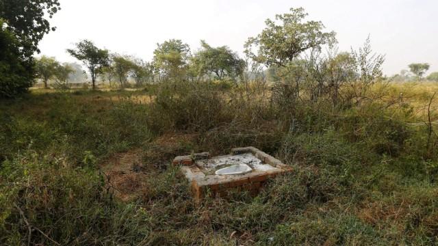 FILE PHOTO: An open toilet is seen in a field in Gorba