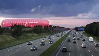 Germany Munich traffic on motorway with lighted Allianz Arena in the background PUBLICATIONxINxGER