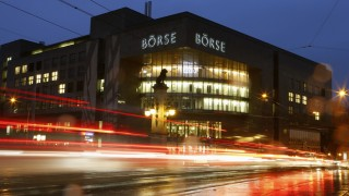 A longtime exposure shows traffic flowing past the building of the Swiss stock exchange in Zurich