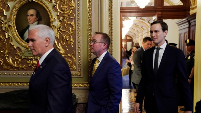 U.S. Vice President Pence, OMB Director Mulvaney and senior advisor Kushner walk between meetings at the U.S. Capitol in Washington