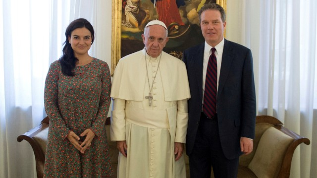 FILE PHOTO: Pope Francis poses with Vatican spokesman Greg Burk and deputy Vatican spokesperson Paloma Garcia Ovejero during a meeting at the Vatican