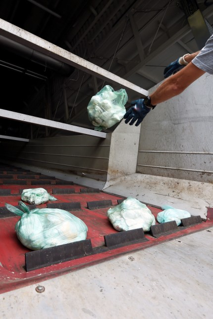 A staff member works in a diaper recycling facility in Spresiano near Treviso