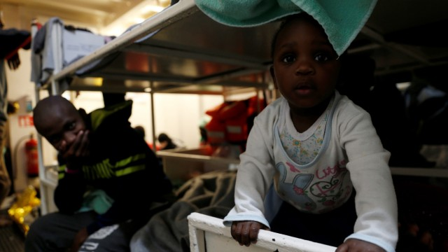 A migrant child plays on the migrant search and rescue ship Sea-Watch 3 off the coast of Malta in the central Mediterranean Sea