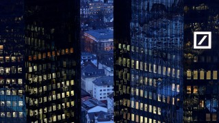 FILE PHOTO: The headquarters of Germany's Deutsche Bank are seen early evening in Frankfurt