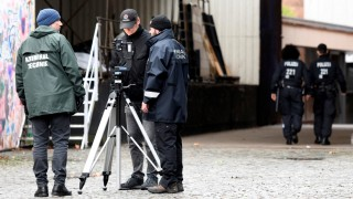 Police forces examine the crime scene, where far-right Alternative for Germany (AfD) party member Frank Magnitz was attacked by unknown assailants, in Bremen
