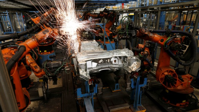 A welding robot creates sparks during the body shell production of a Ford Fiesta at the Ford assembly line in Cologne