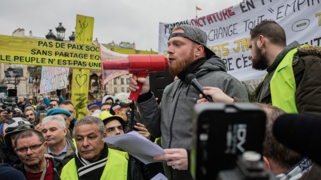 Yellow vest Gilets Jaunes anti government protestor Maxime Nicolle aka Fly Rider during a rally in
