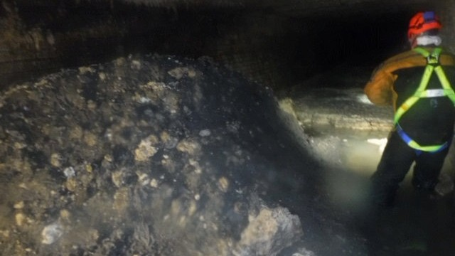 Sewage worker inspects a build up of 'fatberg' in Sidmouth