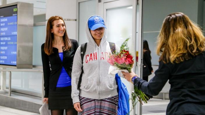 Saudi teenager Rahaf Mohammed al-Qunun arrives in Canada at Toronto Pearson International Airport in Toronto