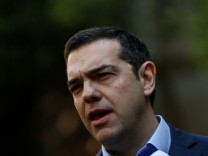 Greek PM Tsipras makes statements to the press following his meeting with resigned coalition partner Panos Kammenos in Athens