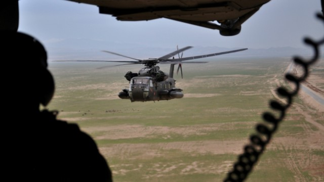 FILE PHOTO: A soldier of the German armed forces Bundeswehr in a CH-53 helicopter on their way from Kunduz to Mazar-i-Sharif