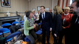 French President Emmanuel Macron attends the city council at the town hall in Gasny before the launching of the 'Great National Debate' designed to find ways to calm social unrest in France
