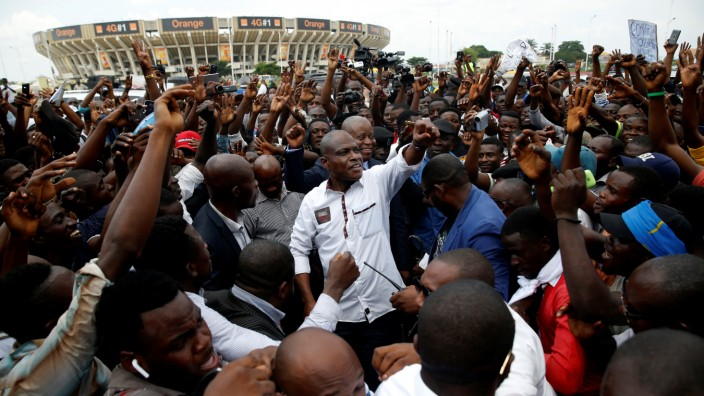 Martin Fayulu, runner-up in Democratic Republic of Congo's presidential election gestures to his supporters as he arrives to a political rally in Kinshasa