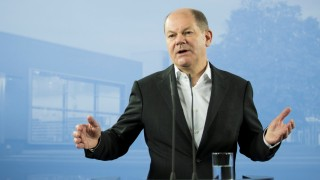 FILE PHOTO: German Finance Minister Olaf Scholz attends a press conference after the federal cabinet meeting in Potsdam