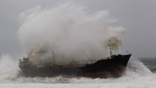 A wave crashes into a ship which broke free from a tow line at Sheffield Beach