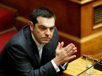 Greek PM Tsipras attends a parliamentary session on confidence vote in Athens