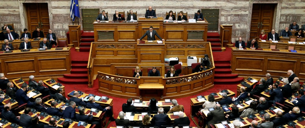 Greek PM Tsipras addresses lawmakers during a parliamentary session on confidence vote in Athens