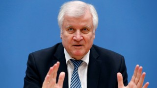 FILE PHOTO: Interior Minister Horst Seehofer address the media during a news conference in Berlin