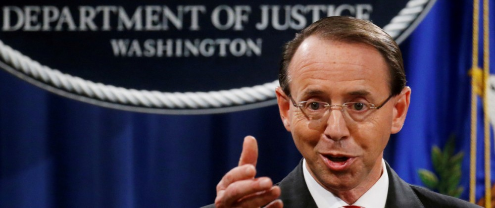 FILE PHOTO: Deputy U.S. Attorney General Rosenstein holds news conference to announce indictments in special counsel Robert Mueller's Russia investigation at the Justice Department in Washington