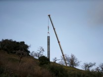 A crane removes steel tubes after failing to place them into the drilled well at the area where Julen, a Spanish two-year-old boy, fell into a deep well nine days ago when the family was taking a stroll through a private estate, in Totalan