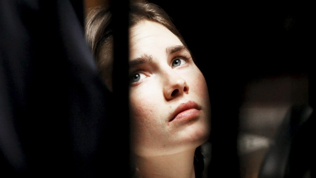 File photo of Amanda Knox, the U.S. student convicted of killing her British flatmate in Italy in 2007, looking on during a trial session in Perugia; Amanda Knocks