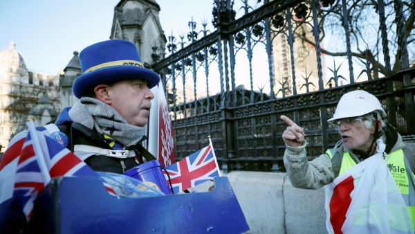 A pro-Brexit protester argues wth anti-Brexit campaigner Steve Bray outside the Houses of Parliament in London