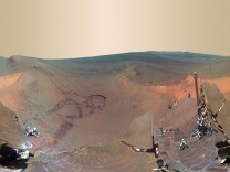 A 360-degree digitally-compressed panorama image of Mars made from some of 800 images sent from the Opportunity rover on Mars