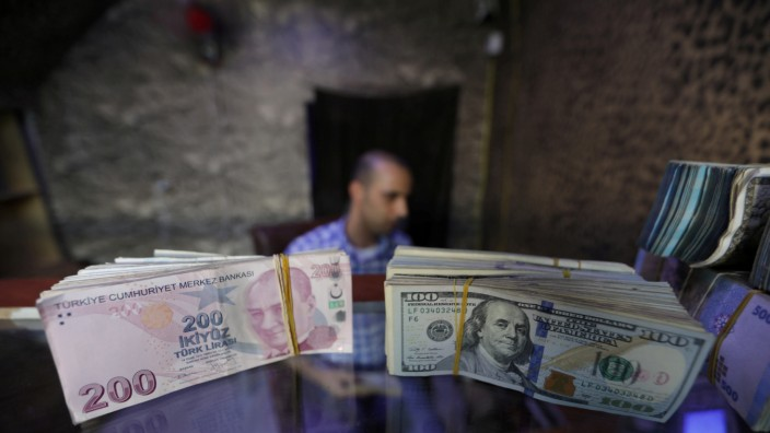FILE PHOTO: Banknotes of U.S. dollars and Turkish lira are seen in a currency exchange shop in Azaz, Syria