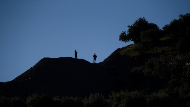 Spanish Civil Guards stand as they guard the area where Julen, a Spanish two-year-old boy, fell into a deep well twelve days ago when the family was taking a stroll through a private estate, in Totalan